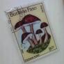切手のブローチ