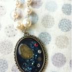 宇宙と時計のネックレス
