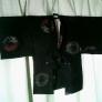 黒羽織の襟と袖をほどいてハーフコートに