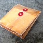 立体的に折った封筒をロウ引きして封かん付に