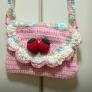 かぎ針編みの苺のポシェット